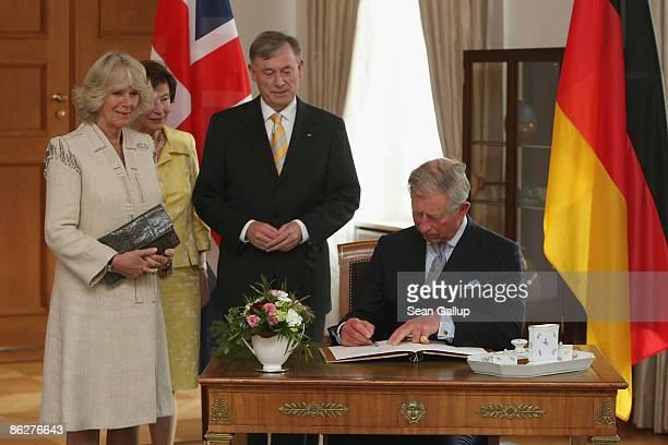 Prince Charles Prince of Wales and Camilla Duchess of Cornwall sign the presidential geust book as German President Horst Koehler and German First...