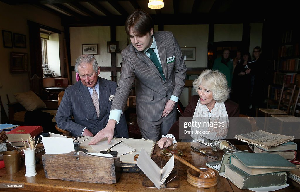 Prince Charles, Prince of Wales and Camilla, Duchess of Cornwall sit at Rudyard Kipling's desk as they visit Bateman's, the East Sussex home of the author Rudyard Kipling, on March 19, 2014 in Burwash, United Kingdom. Bateman's was the secluded family home of the author, who wrote 'Jungle Book' and 'If'.