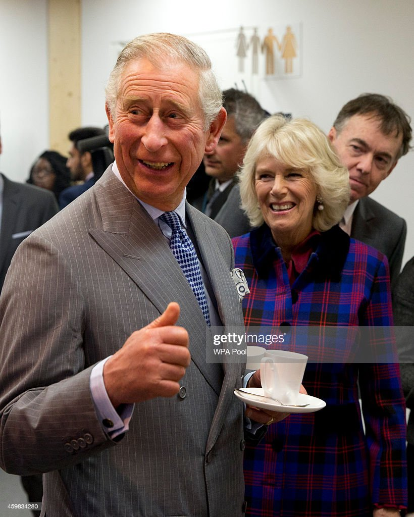 Prince Charles, Prince of Wales and Camilla, Duchess of Cornwall smile during a visit to Sky on December 2, 2014 in London, England.