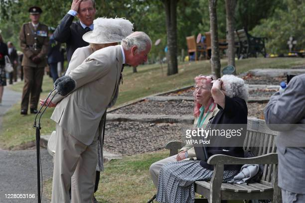 Prince Charles Prince of Wales and Camilla Duchess of Cornwall speak with Jane Elgey nee Reid who was in Singapore when it fell and her daughter...