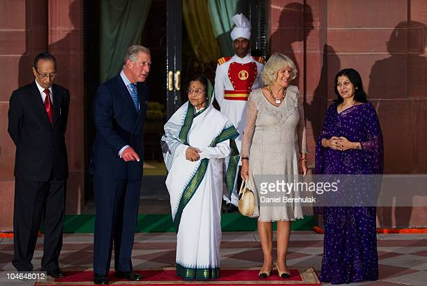 Prince Charles Prince of Wales and Camilla Duchess of Cornwall stand with Indian President Pratibha Patil and her daughter Jyoti Rathore on the first...