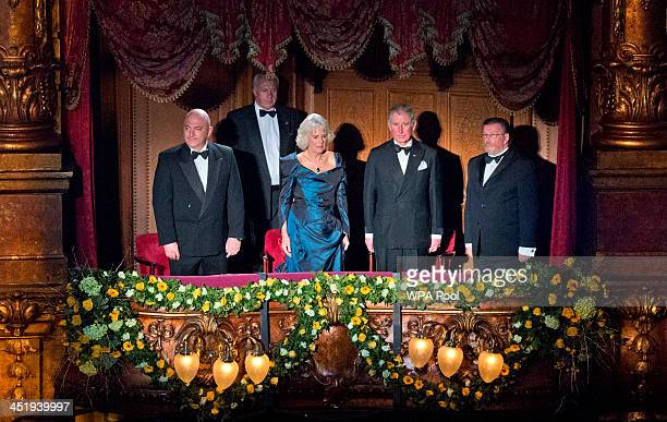 Prince Charles Prince of Wales and Camilla Duchess of Cornwall stand for the national anthem at the Royal Variety Performance at London Palladium on...