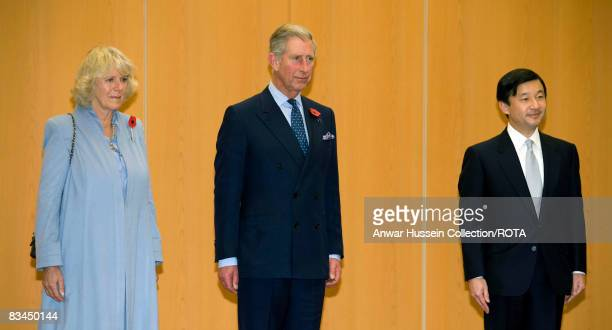 Prince Charles Prince of Wales and Camilla Duchess of Cornwall stand with Crown Prince Naruhito of Japan for the National Anthems after arriving at...