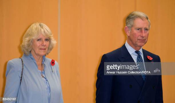 Prince Charles Prince of Wales and Camilla Duchess of Cornwall stand for the National Anthems after arriving at Tokyo International Airport on...