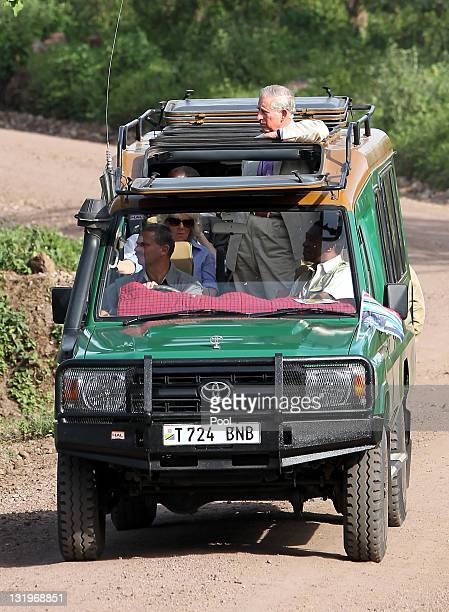 Prince Charles Prince of Wales and Camilla Duchess of Cornwall take an escorted drive through Arusha National Park on November 9 2011 in Arusha...