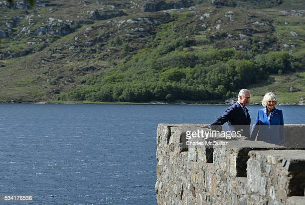 Prince Charles Prince of Wales and Camilla Duchess of Cornwall take in the surroundings from the boathouse roof as they visit Glenveagh Castle on May...