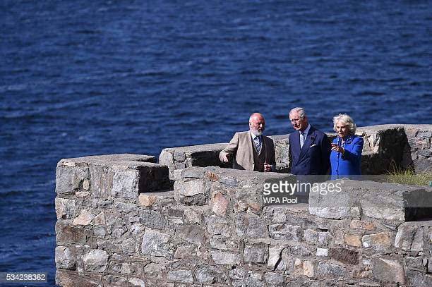 Prince Charles Prince of Wales and Camilla Duchess of Cornwall take in the surroundings from the boathouse roof with their guide Mr Dave Duggan...