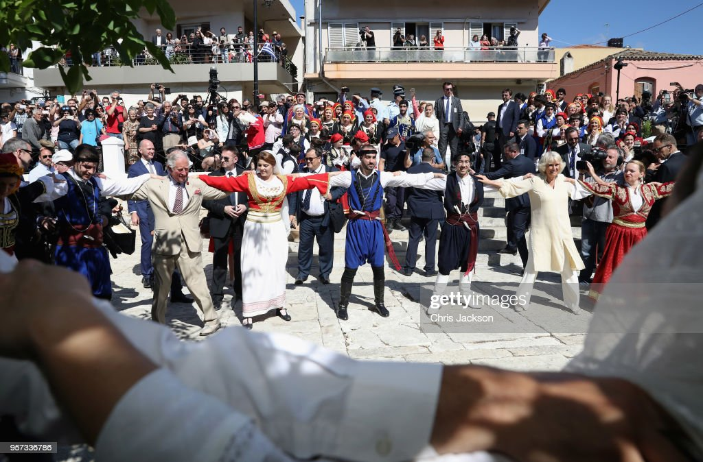 Prince Charles, Prince of Wales and Camilla, Duchess of Cornwall take part in a traditional dance at Church Square on May 11, 2018 in Crete, Greece.