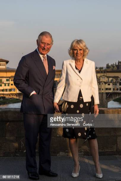 Prince Charles Prince of Wales and Camilla Duchess of Cornwall taking a walk at Santa Trinita Bridge on March 31 2017 in Florence Italy The royal...
