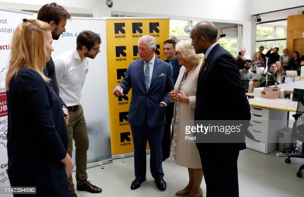 Prince Charles Prince of Wales and Camilla Duchess of Cornwall talk with European chief of IRC Sanj Srikanthan Nele Kapretz the managing director of...
