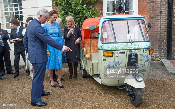 Prince Charles Prince of Wales and Camilla Duchess of Cornwall talks to Yasmin Le Bon and Joanna Lumley at the launch of 'Travels to my Elephant'...