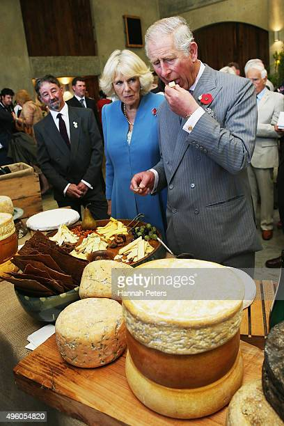 Prince Charles Prince of Wales and Camilla Duchess of Cornwall taste cheese at Mahana Winery on November 7 2015 in Nelson New Zealand The Royal...