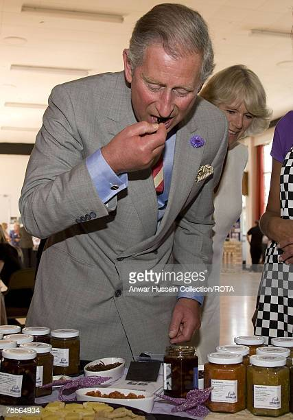 Prince Charles Prince of Wales and Camilla Duchess of Cornwall taste pickles and jams when they visit Chester University on July 19 2007 in Chester...