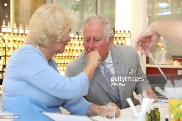 Prince Charles Prince of Wales and Camilla Duchess of Cornwall test various scents during a visit to the Fragonard Perfumery on May 7 2018 in Eze...