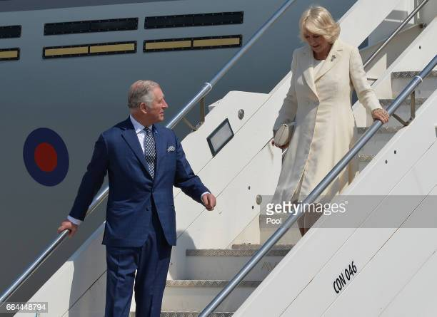 Prince Charles Prince of Wales and Camilla Duchess of Cornwall disembark the royal plane on the seventh day of their nineday European tour on April 4...