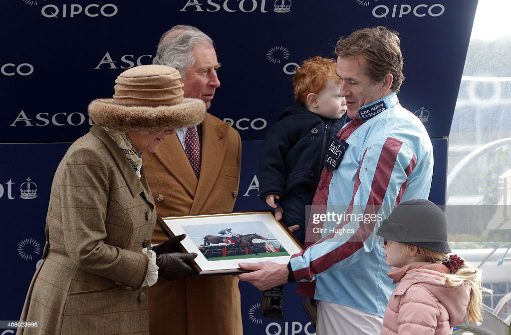 Prince Charles, Prince of Wales (C) and Camilla, Duchess of Cornwall (L) present Tony McCoy and his children Evie (R) and Archie Peader with a framed print on his last race at Ascot the Waitrose Novices' Handicap Steeple Chase at Ascot Racecourse on March 29, 2015 in Ascot, England.