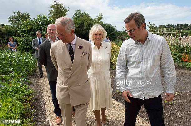 Prince Charles Prince of Wales and Camilla Duchess of Cornwall tour the River Cottage HQ restaurant with the cook and broadcaster Hugh...