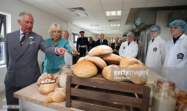 Prince Charles Prince of Wales and Camilla Duchess of Cornwall tour of the Village Bakery on July 7 2015 in Wrexham Wales United Kingdom