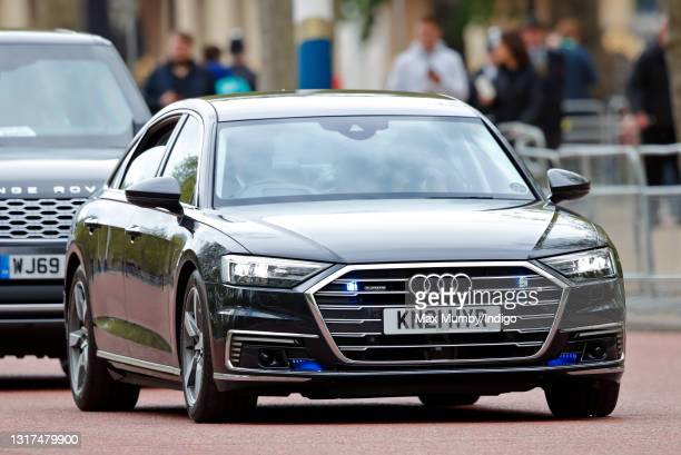 Prince Charles, Prince of Wales and Camilla, Duchess of Cornwall travel down The Mall, in their chauffeur driven Audi A8 car, en route to the Houses...