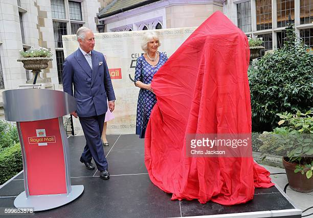 Prince Charles Prince of Wales and Camilla Duchess of Cornwall unveil a penfold postbox as they attend a reception to mark the 500th Anniversary of...