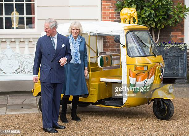 Prince Charles Prince of Wales and Camilla Duchess of Cornwall view a rickshaw as they launch 'Travels to my Elephant' Rickshaw Race at Clarence...