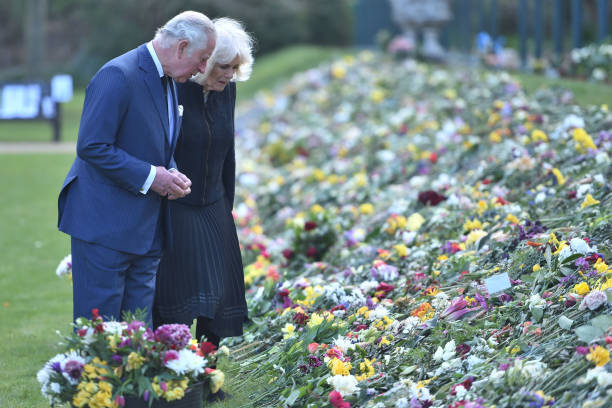 GBR: The Prince Of Wales And The Duchess Of Cornwall View Tributes Left By Members Of The Public Following The Death Of The Duke Of Edinburgh
