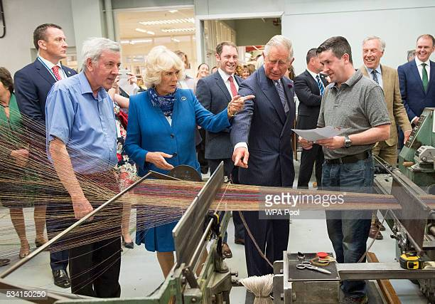 Prince Charles Prince of Wales and Camilla Duchess of Cornwall visit Magee of Donegal's Tweed Factory on May 25 2016 in Letterkenny Ireland The royal...