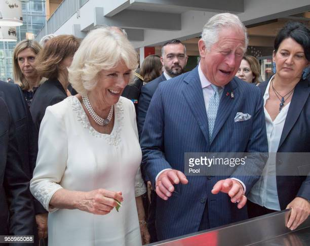 Prince Charles Prince of Wales and Camilla Duchess of Cornwall visit Les Halles de LyonPaul Bocuse food market on May 8 2018 in Lyon France