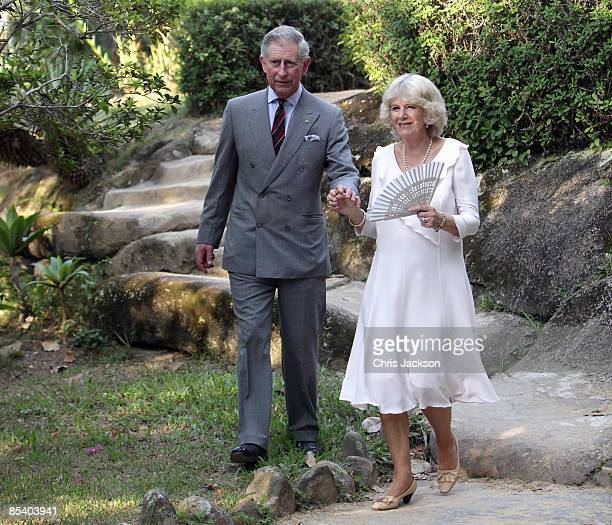 Prince Charles Prince of Wales and Camilla Duchess of Cornwall walk through the Botanical Gardens on March 12 2009 in Rio De Janeiro Brazil The...