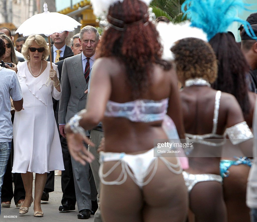 Prince Charles, Prince of Wales and Camilla, Duchess of Cornwall watch traditional Samba dancers perform during a tour of the Marie Complexo Favela on March 12, 2009 in Rio De Janeiro, Brazil. The Prince and the Duchess are in Brazil as part of a ten day tour of South America taking in Chile, Brazil, Ecuador and the Galapagos.
