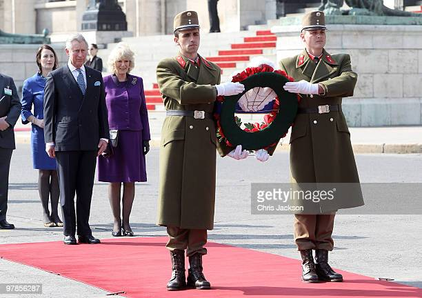 Prince Charles Prince of Wales and Camilla Duchess of Cornwall watch a wreath being laid at the memorial to the 1956 uprising outside the Parliment...