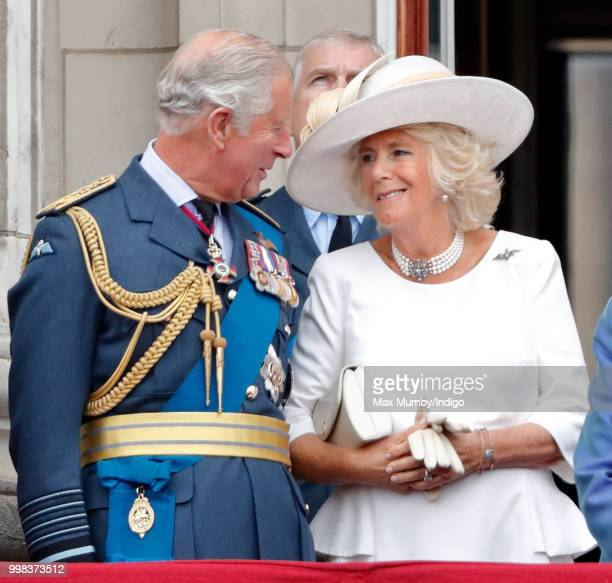 Prince Charles, Prince of Wales and Camilla, Duchess of Cornwall watch a flypast to mark the centenary of the Royal Air Force from the balcony of...
