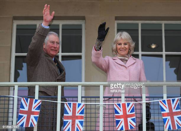 Prince Charles Prince of Wales and Camilla Duchess of Cornwall wave to the crowd during a visit to the Piece Hall in Blackledge on February 16 2018...