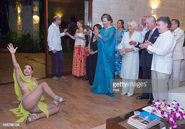 Prince Charles Prince of Wales and Camilla Duchess of Cornwall were entertained by Salsa dancers Gabriela Giraldo Garcia and her brother James...