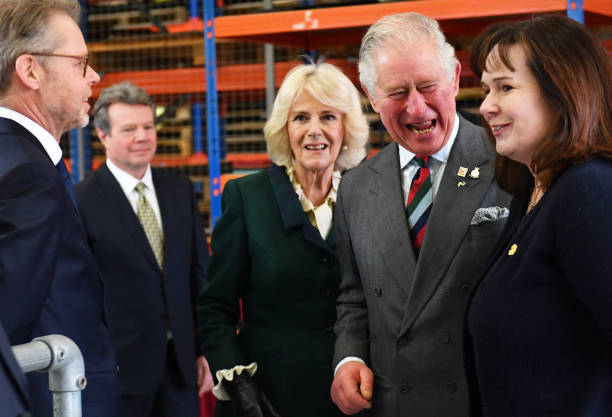 Prince Charles Prince of Wales and Camilla Duchess of Cornwall with founder Julie Deane during a visit to The Cambridge Satchel Company where they...