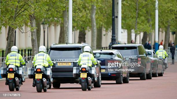 Prince Charles, Prince of Wales and Camilla, Duchess of Cornwall's motorcade travels down The Mall, led by a motorcycle outrider of the Metropolitan...