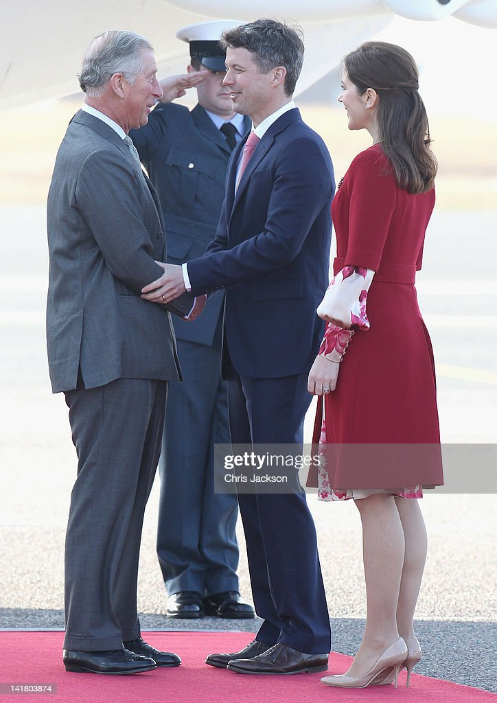 Prince Charles, Prince of Wales and Crown Prince Frederik of Denmark shake hands as Princess Mary of Denmark looks on at Copenhagen Kastrup Airport on March 24, 2012 in Copenhagen, Denmark. Prince Charles, Prince of Wales and Camilla, Duchess of Cornwall are on a Diamond Jubilee tour of Scandinavia that takes in Norway, Sweden and Denmark.