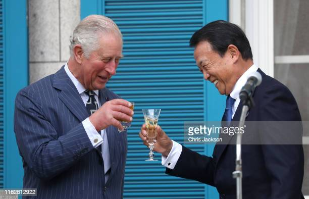 Prince Charles Prince of Wales and Deputy Prime Minister Taro Aso during a reception to celebrate UK Japan partnerships hosted by British Ambassador...