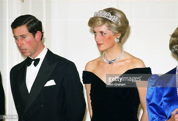 Prince Charles Prince of Wales and Diana Princess of Wales in Germany attending a banquet She is wearing a dress designed by fashion designer Victor...