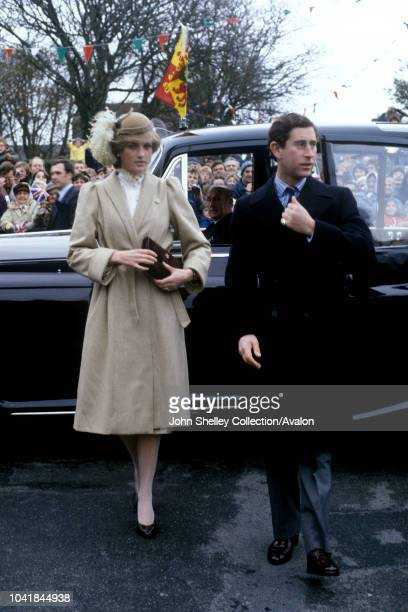 Prince Charles Prince of Wales and Diana Princess of Wales make their first official visit to Wales Diana is wearing a tweed coat by Caroline Charles...