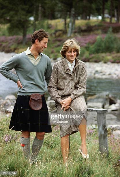 Prince Charles, Prince of Wales and Diana, Princess of Wales smile as they pose together during a honeymoon photocall by the River Dee, The Princess...