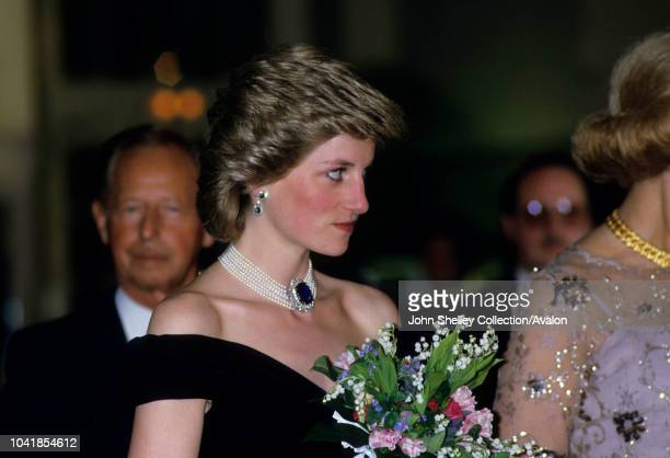 Prince Charles, Prince of Wales, and Diana, Princess of Wales, visit Vienna, Austria, At a state reception, Diana is wearing a midnight blue velvet...