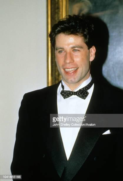 Prince Charles, Prince of Wales, and Diana, Princess of Wales, visit Washington DC, Gala Dinner at the White House, John Travolta, 9th November 1985.