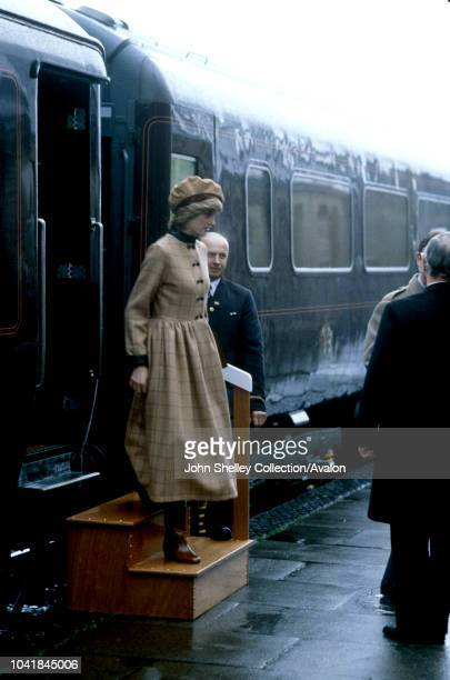 Prince Charles Prince of Wales and Diana Princess of Wales visit West Wales Arriving at Aberdyfi Station Diana's coat dress is made of tan coloured...