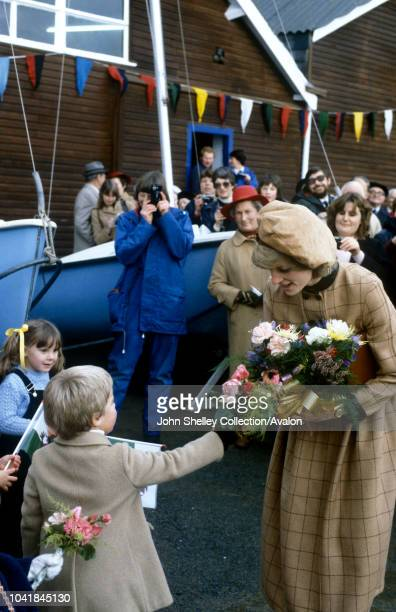 Prince Charles, Prince of Wales, and Diana, Princess of Wales, visit West Wales, Walkabout at Aberdyfi Wharf, Diana's coat dress is made of tan...