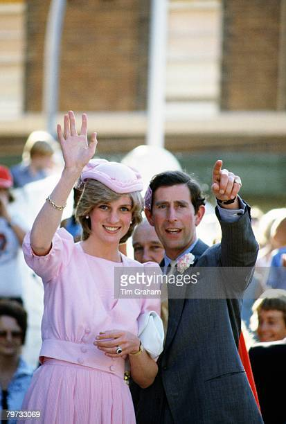 Prince Charles Prince of Wales and Diana Princess of Wales wave to the crowds of wellwishers during their first tour to Australia