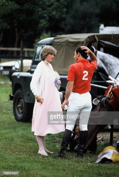 A very pregnant Diana Princess of Wales with Prince Charles Prince of Wales attend a polo event at Windsor Great Park in June 1982 in Windsor England