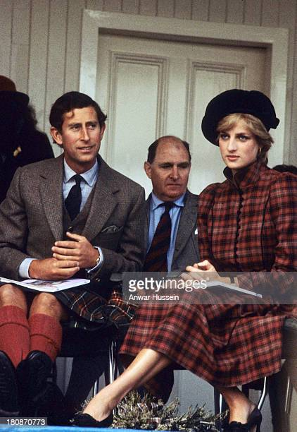 Princess Diana Princess of Wales wearing a Caroline Charles outfit and Prince Charles Prince of Wales attend the Braemar Highland Games on September...