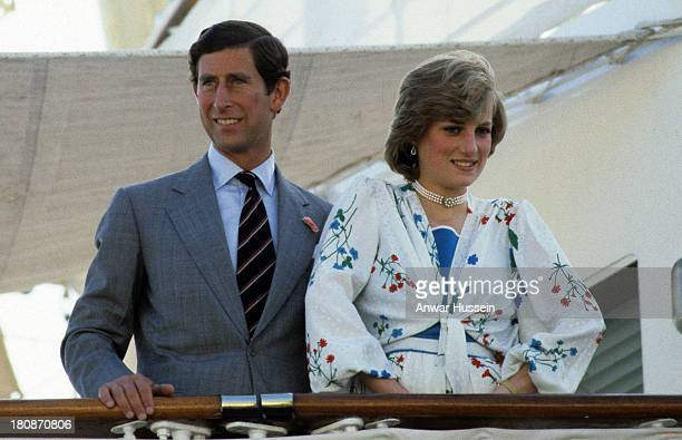 Prince Charles Prince of Wales and Princess Diana Princess of Wales wearing a Donald Campbell dress leave for their honeymoon cruise on the Royal...