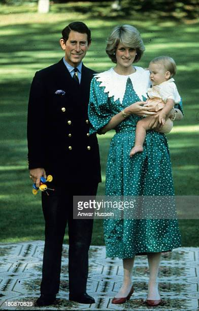 Princess Diana Princess of Wales wearing a Donald Campbell dress and Prince Charles Prince of Wales pose with their baby son Prince William during a...